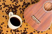 Coffee  And Ukulele On Wood Background