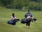 Casal de golfe