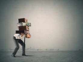 foto of heavy bag  - Businessman carrying heavy suitcases - JPG