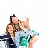 Girl Inside Supermarket Cart With Her Sister