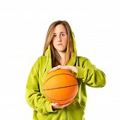 Young Girl With Basketball Over White Background