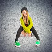 Pretty Young Girl Wearing Urban Style Over Textured Background