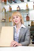 Barmaid At A Bar With Wine List