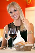 Smiling Woman At Table Having Bread And Wine