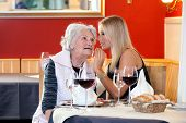picture of niece  - Old and Young Women Talking at Restaurant Table with Glasses of Water Wine and Mini Basket of Bread - JPG