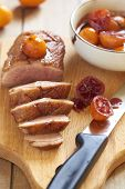 picture of duck breast  - Roasted duck breast in citrus sauce on wooden board - JPG