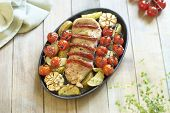 Baked pork with chorizo and vegetables