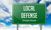 Local Defense on Highway Signpost.