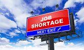 Job Shortage Inscription on Red Billboard.
