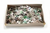 A Cardboard Box Filled With Puzzle Pieces