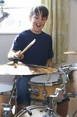 image of drum-kit  - Boy Enjoying Playing Drum Kit At Home - JPG