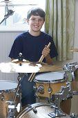 foto of drum-kit  - Portrait Of Boy Playing Drum Kit At Home - JPG