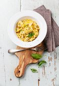 Tortelli Tortellini With Meat Homemade In White Bowl On Olive Wood Cutting Board