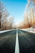 Frozen road on a sunny winter day