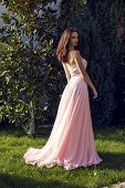Pretty Brunette In Luxurious Dress Posing At Park