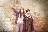 Siblings In Front Of An Old Grungy Brick Wall