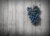 pic of stomp  - bunch of grapes on old wood and desaturated - JPG