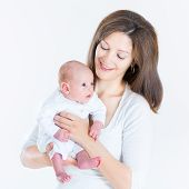 Happy Young Mother Holding Her Newborn Baby