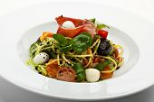 Spaghetti with Vegetables, Ham, Black Olives, Rucola and Pesto Sauce
