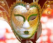 Colorful Venetian carnival mask close up in sunlight