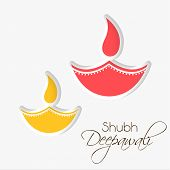 Stylish illuminated oil lit lamp with beautiful decoration and stylish text of shubh deepawali on white background.