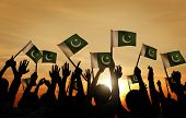 stock photo of pakistani flag  - Group of People Waving Flag of Pakistan in Back Lit - JPG