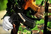 foto of kalashnikov  - Detail with a soldier - JPG