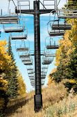 Ski Chair Lift in Autumn Leaves