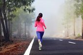picture of country girl  - Healthy running runner woman workout on mountain road - JPG