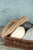 pic of knitted cap  - Knitting yarn and cap in basket - JPG