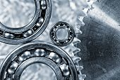 ball-bearings and large cogwheel in close-ups, imaginative concept