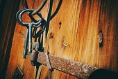 old antique keys and ring against a barn wall, 17th century nostalgia