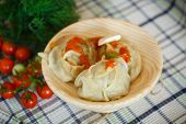 Large Boiled Manti In The Wooden Saucer