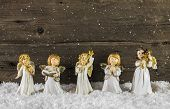 picture of christmas angel  - Christmas decoration with angels on wooden snowy background for a greeting card - JPG