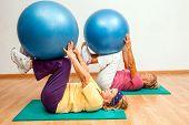 Senior Women Exercising With Gym Balls.