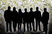 stock photo of por  - Business team silhouettes  against dollar bills   background - JPG