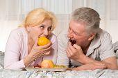 Old Couple L Eats Fruit