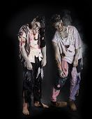 Two Male Zombies Standing On Black Background, Full Length