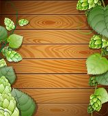Hops On Wooden Background