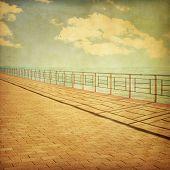 Beach pier in grunge and retro style.