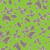 Leaves seamless pattern on green background.