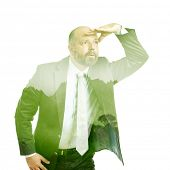 An image of a business man double exposure green tree
