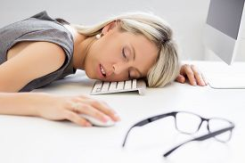 foto of fail job  - Exhausted business woman sleeping in front of computer - JPG
