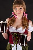 blond woman Oktoberfest with beer in hand
