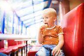 Little boy in cafe