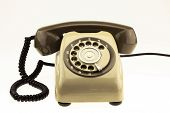 vintage picture style of new smart phone with old telephone on white background. New communication