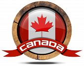 foto of canada maple leaf  - Wooden icon or symbol with Canadian flag and red ribbon with text Canada - JPG