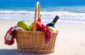 Picnic Basket With Fruits By The Ocean
