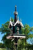 picture of pigeon loft  - green with white painted birdhouse for doves - JPG