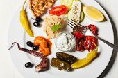foto of ouzo  - variety of greek appetizers on a plate - JPG